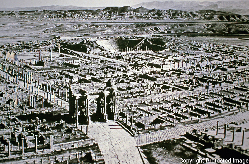 Aerial view of the ruins of the Roman city of Timgad showing Roman Triumphal Arch of Trajan.
