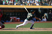OAKLAND, CA - SEPTEMBER 20:  Ramon Laureano #22 of the Oakland Athletics bats against the Los Angeles Angels of Anaheim during the game at the Oakland Coliseum on Thursday, September 20, 2018 in Oakland, California. (Photo by Brad Mangin)