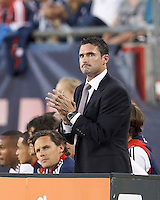 New England Revolution coach Jay Heaps. In a Major League Soccer (MLS) match, the New England Revolution defeated Vancouver Whitecaps FC, 4-1, at Gillette Stadium on May 12, 2012.