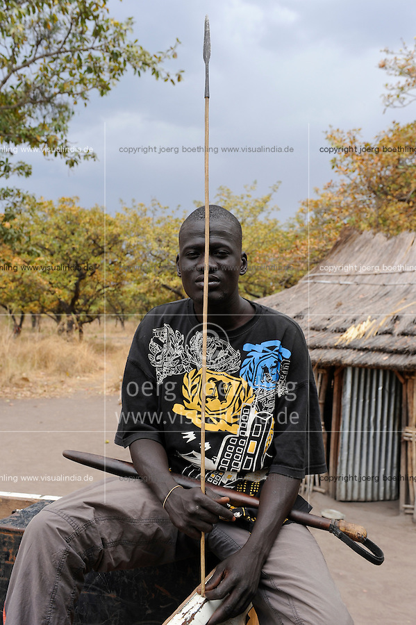 SOUTH-SUDAN Rumbek , village, Colocok, Dinka warrior with spear / SUED SUDAN, Rumbek,  Dinka Dorf Colocok, Dinka Krieger mit Speer