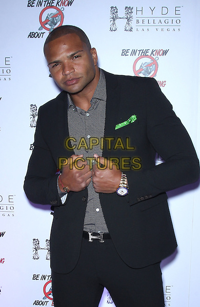 Brendon Ayanbadejo<br /> Hyde Bellagio hosts &quot;Be In The Know About Bullying&quot;  Event, Las Vegas, Nevada, USA.<br /> September 28th, 2013<br /> half length black suit grey gray shirt<br /> CAP/ADM/MJT<br /> &copy; MJT/AdMedia/Capital Pictures