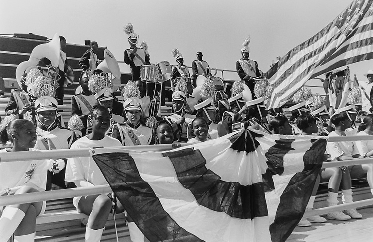 Eastern Senior High School Students and band members gathered on the bleachers just before Clinton's arrival, Washington, D.C., on May 13, 1996. (Photo by Laura Patterson/CQ Roll Call via Getty Images)