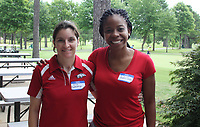 NWA Democrat-Gazette/CARIN SCHOPPMEYER Erica Frankenberger (left) and Candice Graham help out at the Ronnie Brewer Foundation golf tournament June 22 at Paradise Valley Golf and Athletic Club in Fayetteville.