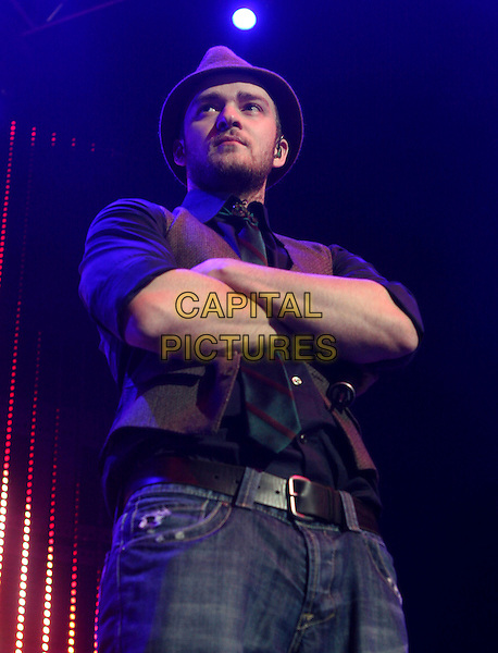 JUSTIN TIMBERLAKE.Performs live at The KIIS FM Jingle Ball 2006 held at The Honda Center in Anaheim, California, USA. .December 7th, 2006.half length stage concert music gig performance hat waistcoat arms crossed.CAP/DVS.©Debbie VanStory/Capital Pictures