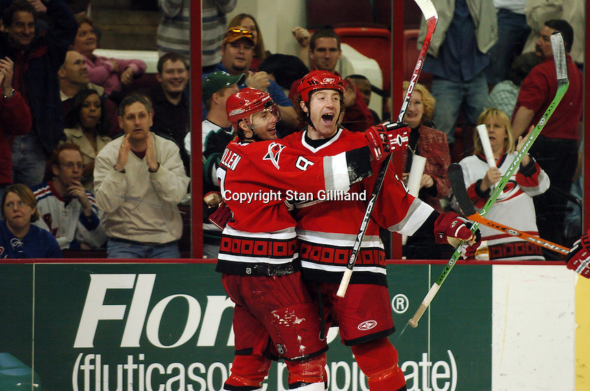 Carolina Hurricanes' defenseman Mike Commodore celebrates his third period goal against the New York Rangers with teammate Matt Cullen (8) Tuesday, March 14, 2006 at the RBC Center in Raleigh, NC. Carolina won 5-3.