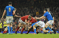Wales Bradley Davies is tackled by Italy&rsquo;s Giovanni Licata<br /> <br /> Photographer Ian Cook/CameraSport<br /> <br /> 2018 NatWest Six Nations Championship - Wales v Italy - Sunday 11th March 2018 - Principality Stadium - Cardiff<br /> <br /> World Copyright &copy; 2018 CameraSport. All rights reserved. 43 Linden Ave. Countesthorpe. Leicester. England. LE8 5PG - Tel: +44 (0) 116 277 4147 - admin@camerasport.com - www.camerasport.com