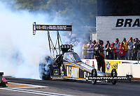 Aug. 16, 2013; Brainerd, MN, USA: NHRA top fuel dragster driver Tony Schumacher during qualifying for the Lucas Oil Nationals at Brainerd International Raceway. Mandatory Credit: Mark J. Rebilas-