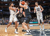 WASHINGTON, DC - JANUARY 28: Jagan Mosely #4 of Georgetown sends the ball past Bryce Golden #33 of Butler during a game between Butler and Georgetown at Capital One Arena on January 28, 2020 in Washington, DC.