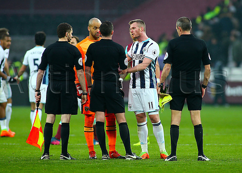 February 11th 2017, London Stadium, London, England, Premier League football, West Ham versus West Bromwich Albion; West Ham Goalkeeper Darren Randolph appeals to Referee Michael Oliver at full time, regarding West Brom's late equaliser and a suspected foul, as Chris Brunt of West Brom defends the decision