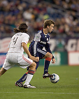 New England Revolution forward Zack Schilawski (15) traps the ball as Toronto FC defender Nick Garcia (4) defends. New England Revolution forward Zack Schilawski (15) scored  3 goals. The New England Revolution defeated Toronto FC, 4-1, at Gillette Stadium on April 10, 2010.