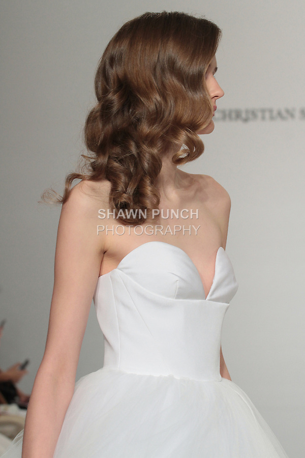 Model walks runway in a strapless tulle ball gown, from the Christian Siriano for Kleinfeld bridal collection, at Kleinfeld on April 18, 2016 during New York Bridal Fashion Week Spring Summer 2017.