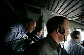 United States President George W. Bush rides in the cockpit of Air Force One on the final approach before landing in Baghdad Tuesday, June 13, 2006. <br /> Mandatory Credit: Eric Draper / White House via CNP