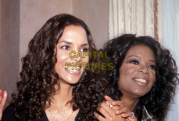 HALLE BERRY & OPRAH WINFREY.March 2005.headshot portrait.www.capitalpictures.com.sales@capitalpictures.com.© Capital Pictures.