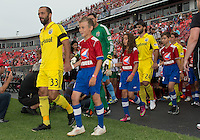 July 20, 2013: Columbus Crew forward Federico Higuain #33 leads his team onto the pitch during the opening ceremonies in a game between Toronto FC and the Columbus Crew at BMO Field in Toronto, Ontario Canada.<br /> Toronto FC won 2-1.