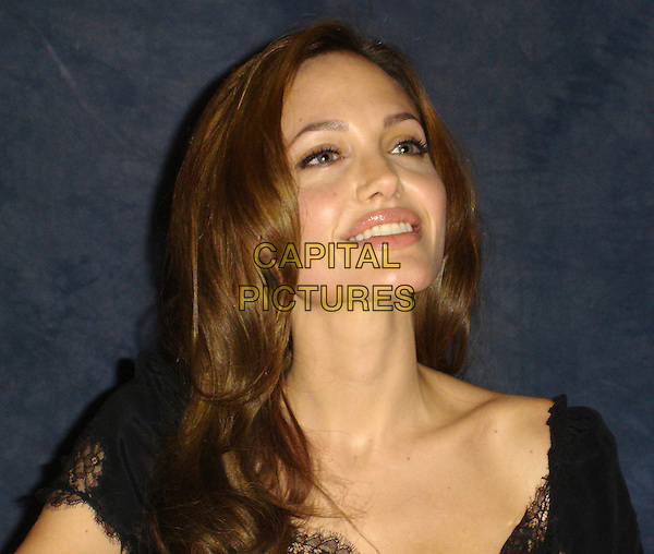 "ANGELINA JOLIE.Photocall for ""A Mighty Heart"", Le Grand Trianon, Beverly Wilshire Hotel, Beverly Hills, California..June 6th, 2007.headshot portrait .CAP/AW.©Anita Weber/Capital Pictures"