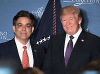 Hector Barreto, chairman of the Latino Coalition and  former United States  Small Business Administrator, left, welcomes US President Donald J. Trump who will make remarks at the Latino Coalition Legislative Summit at the JW Marriott Hotel in Washington, DC on Wednesday, March 7, 2018.<br /> <br /> CAP/MPI/CNP/RS<br /> &copy;RS/CNP/MPI/Capital Pictures