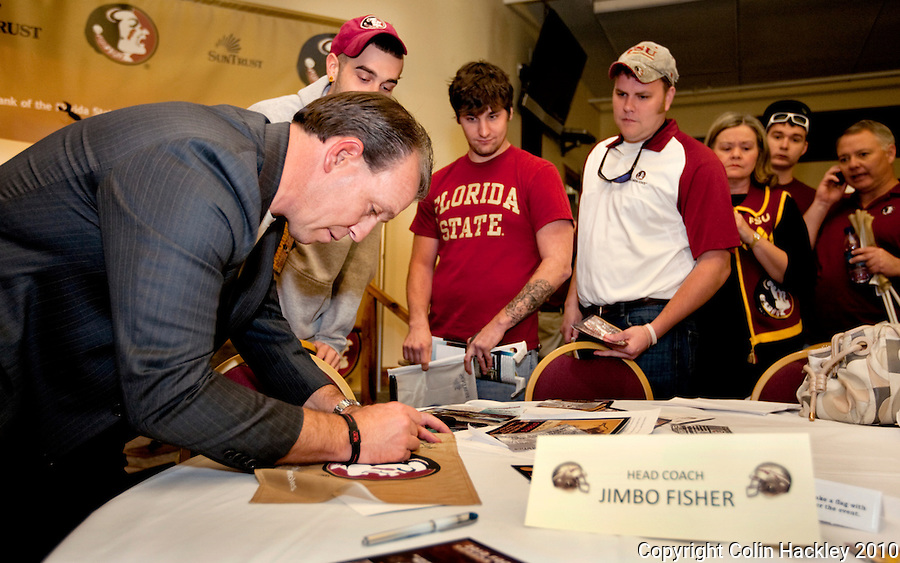 TALLAHASSEE, FLA. 2/3/10-FSU SIGN10 CH32-Head Coach Jimbo Fisher signs autographs after the FSU Signing Day Spectacular Wednesday in Tallahassee...COLIN HACKLEY PHOTO