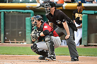 Tim Federowicz (23) of the Albuquerque Isotopes behind the plate with home plate umpire Shaun Lampe during the game against the Salt Lake Bees at Smith's Ballpark on May 21, 2014 in Salt Lake City, Utah.  (Stephen Smith/Four Seam Images)