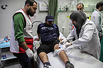 Paramedicals treat a wounded Palestinian protester, who was injured by Israeli security forces at the Gaza-Israel maritime border, at a hospital in Jabalia in the northern Gaza Strip, February 19, 2019. At least 20 Palestinians were injured as Israeli forces suppressed the 24th naval march along the northern besieged Gaza Strip, on Tuesday afternoon. Photo by Ramez Haboub
