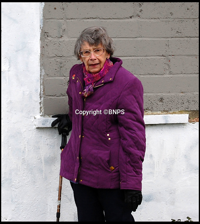 BNPS.co.uk (01202 558833)<br /> Pic:PhilYeomans/BNPS<br /> <br /> Joyce Warren(82) - watched the Luftwaffe flatten the airfield from her garden during the Battle of Britain on 16th August 1940.<br /> <br /> A campaign has been launched to restore a historic Second World War airfield control tower which has fallen into an alarming state of disrepair.<br /> <br /> RAF Tangmere in West Sussex was one of Britain's most important airfields during the Battle of Britain and was the base of double amputee flying ace Douglas Bader.<br /> <br /> It closed down in 1970 and most of its buildings were knocked down to create room for houses.<br /> <br /> Sadly, all that remains of the iconic watch tower today is a dilapidated shell covered in graffiti in the middle of an overgrown field.