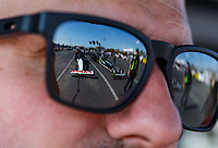 Feb 9, 2018; Pomona, CA, USA; The dragster of NHRA top fuel driver Steve Torrence reflects in the sunglasses of crew member Gary Pritchett during qualifying for the Winternationals at Auto Club Raceway at Pomona. Mandatory Credit: Mark J. Rebilas-USA TODAY Sports