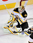 24 September 2009: Boston Bruins' goaltender Tim Thomas makes a third period save against the Montreal Canadiens at the Bell Centre in Montreal, Quebec, Canada. The Bruins edged out the Canadiens in an overtime shootout 2-1 in their pre-season matchup. Mandatory Credit: Ed Wolfstein Photo