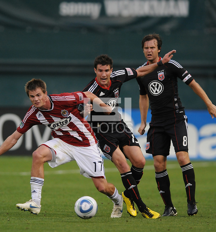 Chivas USA forward Justin Braun (17) shields the ball against DC United forward Chris Pontius (13).  DC United defeated Chivas USA 3-2 at RFK Stadium, Saturday May 29, 2010.
