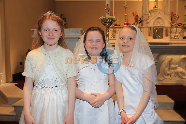 Sarah Blake, Sophie Megan Molly Rock.at First Comunion in Termonfeckin church..Picture:  www.newsfile.ie ..