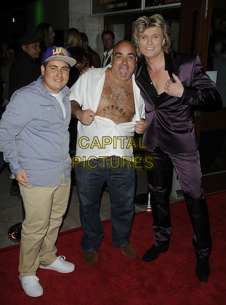 Michalakis ( Lagi ), Demetrios aka Stavros Flatley & Hans Klok .Hans Klok's 'The Houdini Experience' Press Night at the Peacock Theatre, London, England..February 28th 2012.full length blue beige jeans denim trousers shirt unbuttoned tattoos hat purple suit .CAP/CAN.©Can Nguyen/Capital Pictures.