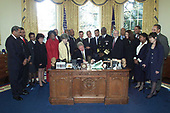 In this photo released by the White House, United States President Bill Clinton signs the Minority Health and Health Disparities Research and Education Act of 2000 in the Oval Office of the White House in Washington, DC on November 22, 2000.<br /> Mandatory Credit: David Scull / White House via CNP