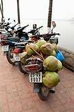 VIETNAM, Hanoi, a moped is loaded down with coconuts at the Tran Quoc Pagota