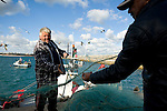 Fisherman and scenes of fishing at Sagres Port in SouthWest Portugal
