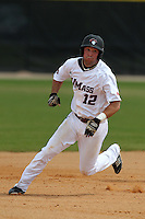 UMass Rich Graef #12 during a game vs Indiana Hoosiers at Lake Myrtle Main Field in Auburndale, Florida;  March 16, 2011.  Indiana defeated UMass 11-10.  Photo By Mike Janes/Four Seam Images