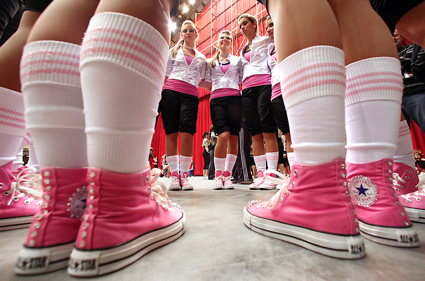 Sporting pink Converse All Stars, the Norwalk dance team huddles backstage for some final inspiration moments before performing at the 2010 Iowa State Dance/Drill Team Championships Friday at Veterans Memorial Auditorium.  About 5000 participants from 275 high school teams and 23 college teams will perform 550 routines during the two-day competition through Saturday.