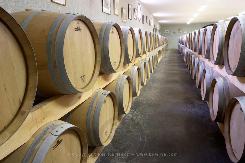 Oak barrel aging and fermentation cellar. Chateau Saint Christoly, Medoc, Bordeaux, France