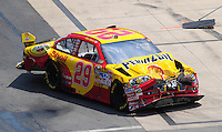 Jun 1, 2008; Dover, DE, USA; NASCAR Sprint Cup Series driver Kevin Harvick pulls into his garage stall after crashing during the Best Buy 400 at the Dover International Speedway. Mandatory Credit: Mark J. Rebilas-US PRESSWIRE