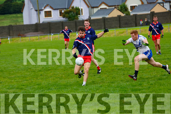 An Ghaeltacht's Tomás Ó Sé in front of goal makes no mistakes as St Mary's Darragh O'Sullivan tries to block.