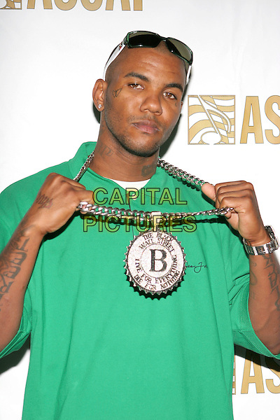 THE GAME aka JAYCEON TAYLOR.ASCAP Presents the 18th Annual Rhythm & Soul Music Awards held at the Beverly Hilton Hotel, Beverly Hills, California, USA, 27 June 2005..half length green Sean John T-shirt t polo shirt necklace bling chain B pendant tattoo butterfly on cheek face.Ref: ADM.www.capitalpictures.com.sales@capitalpictures.com.©Zach Lipp/AdMedia/Capital Pictures.