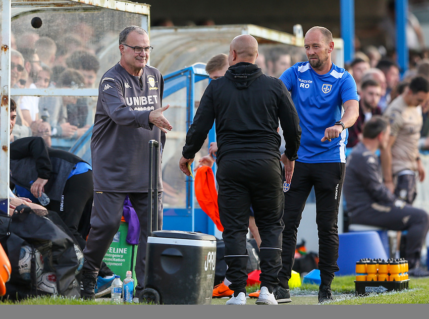 Leeds United manager Marcelo Bielsa shakes hands with Guiseley managers Marcus Bignot and Russ O'Neil before the game<br /> <br /> Photographer Alex Dodd/CameraSport<br /> <br /> Football Pre-Season Friendly - Guiseley v Leeds United - Thursday July 11th 2019 - Nethermoor Park - Guiseley<br /> <br /> World Copyright © 2019 CameraSport. All rights reserved. 43 Linden Ave. Countesthorpe. Leicester. England. LE8 5PG - Tel: +44 (0) 116 277 4147 - admin@camerasport.com - www.camerasport.com