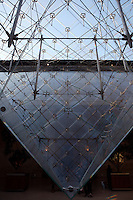 PARIS, FRANCE - FEBRUARY 8 : A detail of the structure of the pyramid at the Louvre on February 8, 2008 in Paris, France. The pyramid was designed by the American architect I M Pei and opened to the public in 1989 for the bicentennial of the French Revolution. Built of 666 glass lozenges on a steel frame, the pyramid forms the main entrance of the Louvre museum. (Photo by Manuel Cohen)