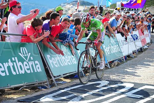 08.09.2012. Faisanera - Bola del Mundo, Spain.  Vuelta a Espana, tappa 20 La Faisanera - Bola del Mundo, Katusha 2012, Rodriguez Oliver Joaquin crosses the finsh line in Bola del Mundo