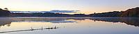 The sun rises over the far Pete's Lake shoreline, Pete's Lake, Hiawatha National Forest, Alger County, Michigan