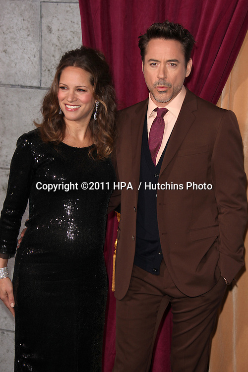 """LOS ANGELES - DEC 6:  Robert Downey Jr and wife Susan Downey arrives at the """"Sherlock Holmes: A Game of Shadows"""" Los Angeles Premiere at Regency Village Theatre on December 6, 2011 in Westwood, CA"""
