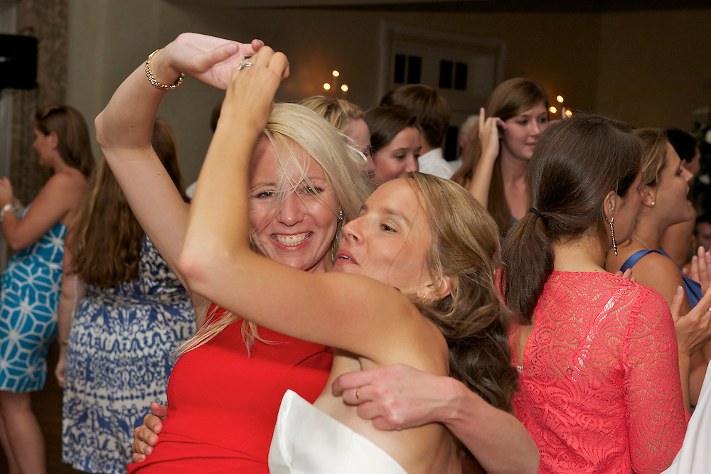 The bride dancing with a friend.