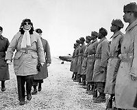 General of the Army Douglas MacArthur is shown inspecting troops of the 24th Inf. on his arrival at Kimpo airfield for a tour of the battlefront.  February 21, 1951.  INP.  (USIA)