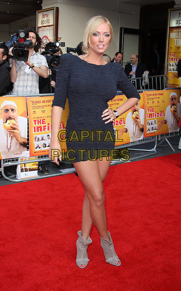 AISLEYNE HORGAN-WALLACE.Attending the World Premiere of  'The Infidel' at the Hammersmith Apollo, London, England, UK, April 8th 2010.arrivals  full length black dress ruched body con hand on hip shoulder pads eighties grey gray peep toe beige ankle boots .CAP/ROS.©Steve Ross/Capital Pictures.