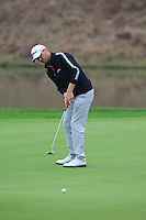 Michael Hoey (NIR) putts on the 18th green during Saturay's Round 3 of the 2014 BMW Masters held at Lake Malaren, Shanghai, China. 1st November 2014.<br /> Picture: Eoin Clarke www.golffile.ie