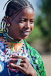 Young Fulani woman in the seasonal village of Bantagiri in northern Burkina Faso.  The Fulani are traditionally nomadic pastoralists, crisscrossing the Sahel season after season in search of fresh water and green pastures for their cattle and other livestock.