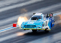 Jul 22, 2017; Morrison, CO, USA; NHRA funny car driver Tim Wilkerson does a wheelstand during qualifying for the Mile High Nationals at Bandimere Speedway. Mandatory Credit: Mark J. Rebilas-USA TODAY Sports
