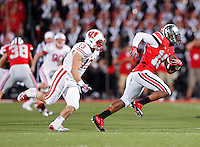 Ohio State Buckeyes wide receiver Philly Brown (10) cuts back to elude Wisconsin Badgers linebacker Conor O'Neill (13) in the second half at Ohio Stadium on September 28, 2013.  (Chris Russell/Dispatch Phot0)
